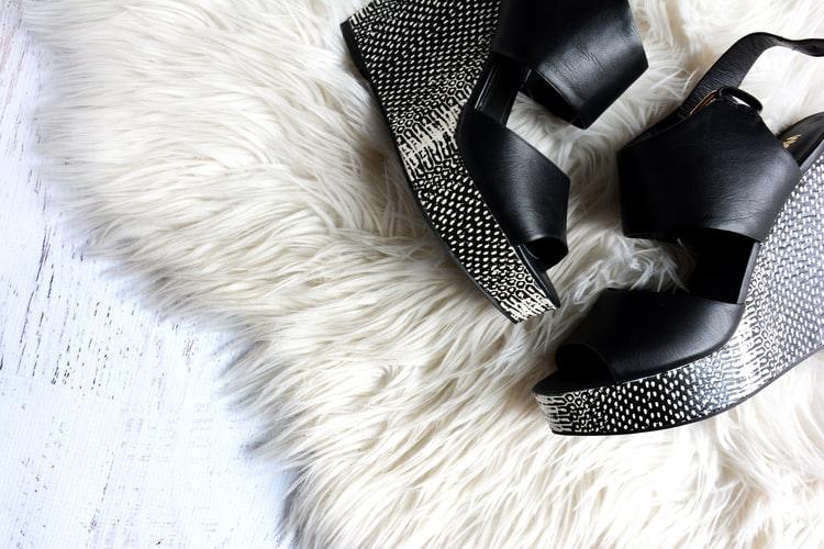 Black Shoes White Carpet